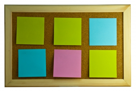 Six post-it notes on cork board photo