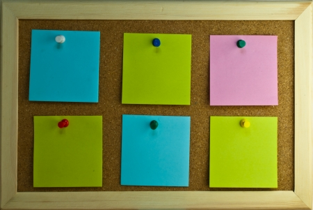 Six post-it notes with pins on cork board Stock Photo - 17119316