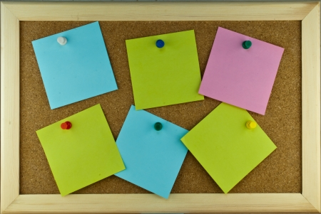 Six post-it note scatering on cork board Stock Photo - 17119698