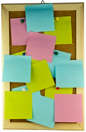 Numerous post-it note scatering on cork board photo