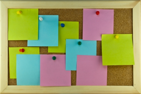 Numerous post-it note scatering on cork board Stock Photo - 17119289