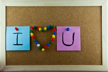Post-it note and heart shape pins on corkboard Stock Photo - 17160567
