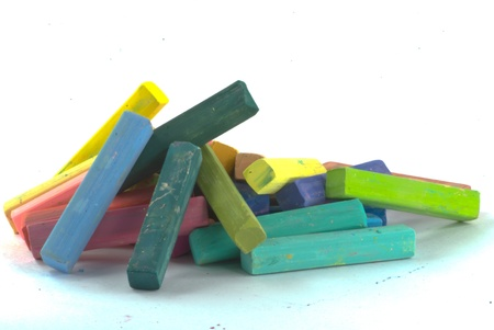A stack of pastel crayon colors