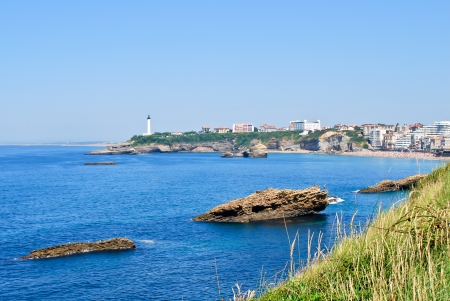 Lighthouse, rocks and grass at Biarritz, France photo