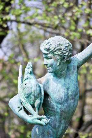 angels fountain: The bronze statue, a man holding chicken Stock Photo