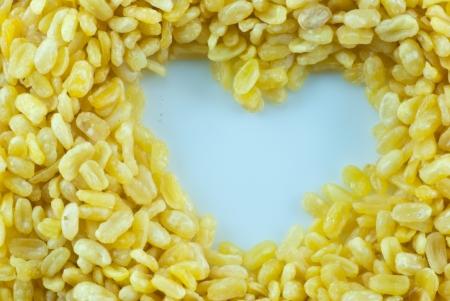 golden bean: Golden bean texture in heart shape