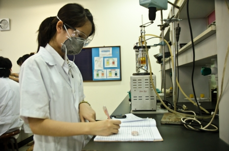 A young researcher using an apparatus in a laboratory. Editorial