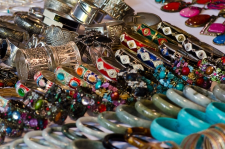 Rows of colorful hand-made bracelets - shallow DOF. Stock Photo