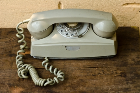 Vintage telephone on old table sepia photo photo