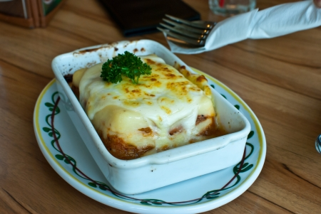 Italian lasagna in a square plate photo