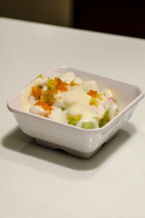 a salad in a white cup photo