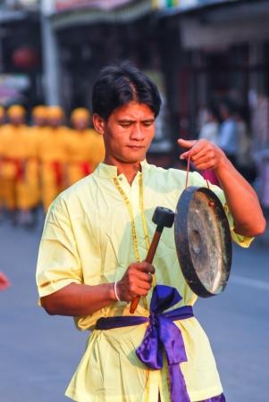 reign: Man playing Thai music instrument the King Narai Reign Fair, Lopburi, Thailand Editorial