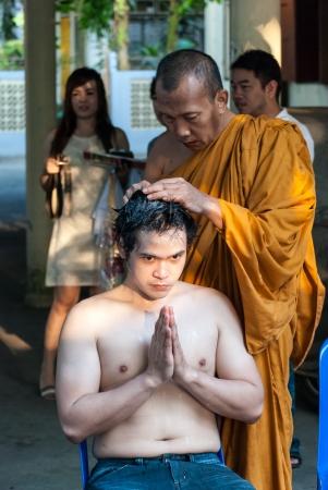 ordination: The new monks in Buddhist ordination ceremony, Lopburi, Thailand Editorial