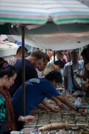 A street vendor sells buddha images