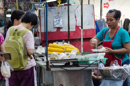 People buy food street vendors in Bangkok, Thailand Stock Photo - 22746064