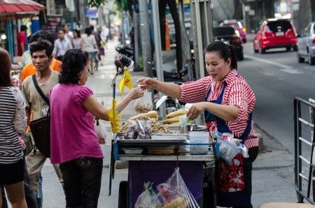 People buy food street vendors in Bangkok, Thailand Stock Photo - 22746069