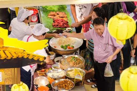 People buy food street vendors in Bangkok, Thailand