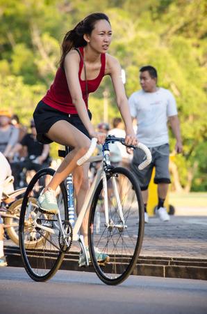 People excercing on bike in park