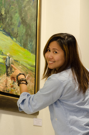 travler: Young Asian woman smiling in the art gallery  Stock Photo