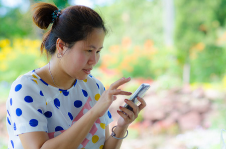 A shot of Asian woman using the smart phone