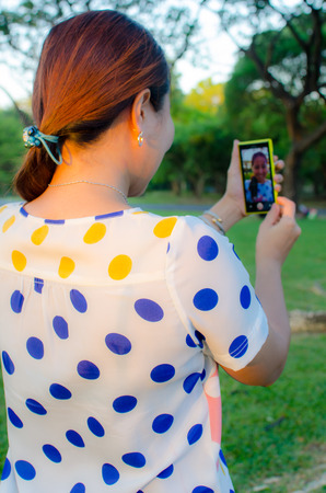 Asian woman taking a self portrait with smart phone  Stock Photo