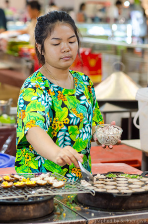 A street vendor prepares food Stock Photo - 27171982