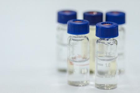 analytical chemistry: Analytical chemistry sample vial (blue screw cap) Stock Photo