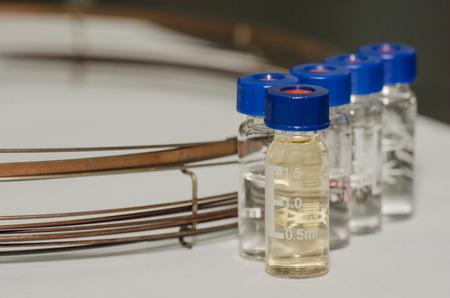 analytical chemistry: Analytical chemistry sample vial (blue screw cap) with column