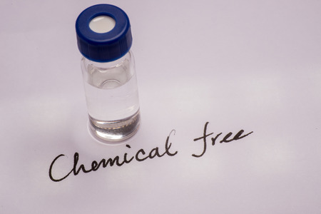 spectrometry: Sample vial on paper with handwritten chemical formula