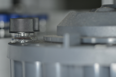 sample tray: Sample vial are waiting for analysis in plastic tray Stock Photo