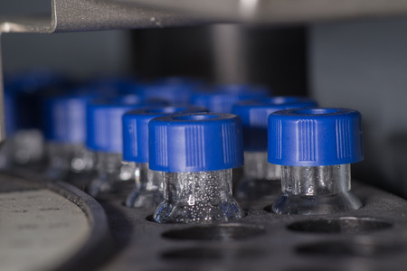 spectrometry: Sample vials in line waiting for analysis inside injection port
