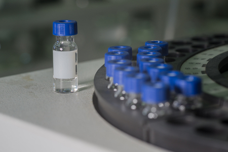spectrometry: Sample vials in line waiting for analysis - one vial out of tray