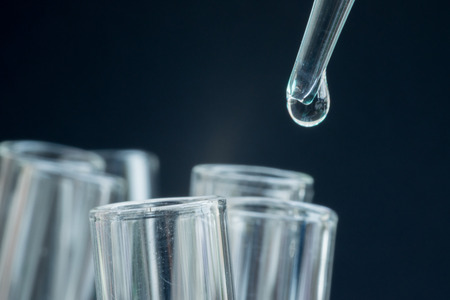 spectrometry: Close-up of water drop on test tube