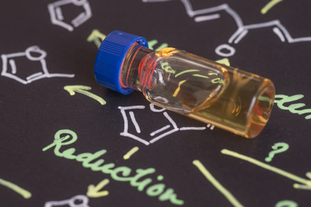 spectrometry: Close-up blue cap sample vial on paper with chemical formula Stock Photo