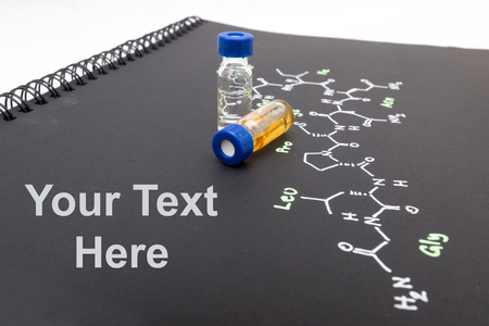 oxytocin: Close-up blue cap sample vial on notebook with chemical formula of Oxytocin (love hormone) with text space