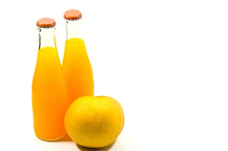 Two bottles of orange juice and one pear isolated on white background photo