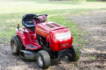 A red lawn mower in fresh cut grass. photo