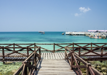 Amazing Island Paradise Beach With Wooden Bridge Alongside photo