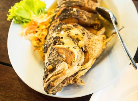 side salad: Fried Fish served with side salad