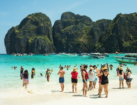 phi: PHI PHI ISLAND,THAILAND-April 21, 2015: Tourists on the wonderful Maya beach of Phi Phi Leh island Thailand on April 21, 2015.