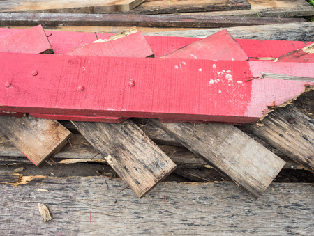 protruding: A scrap wood pile with protruding rusty nails.