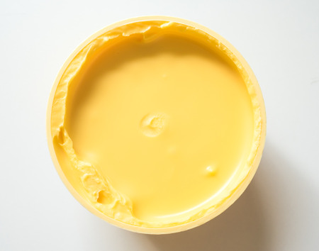 margarine: Top view of bowl with creamy margarine.