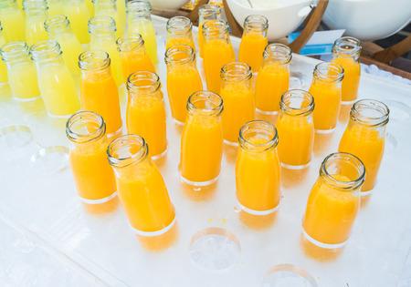 pineapple  glass: Fresh orange juice and pineapple juice in bottles glass.
