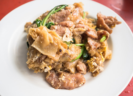 Stir-fried Noodles in Sweet Soy Sauce with Pork ( Pad See-Ew ).