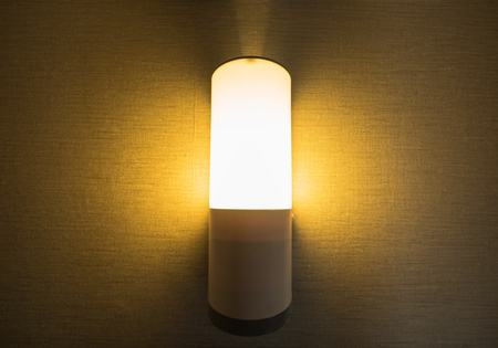 Wall lamp with yellow shade from fabric. Stock Photo - 91872410