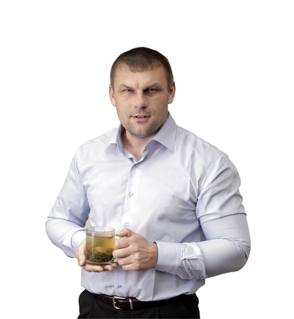stocky: A tired man with a glass of green tea in hand on white background