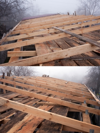 rafters: General view of the wooden rafters in the roof construction in foggy weather Stock Photo