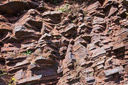 the crags: Fragment of shale rock - Skansen in Krivoy Rog in Ukraine Stock Photo