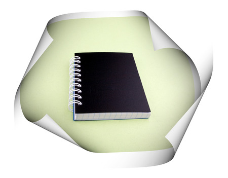 curled edges: Closed notebook with a black cover on a white spiral on light green piece with curled edges