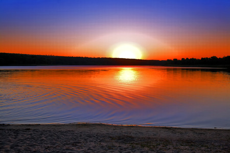 sooth: Water landscape with a red sunset in the background of the water surface